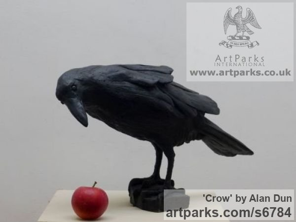 Cast resin Wild Animals and Wild Life sculpture by sculptor Alan Dun titled: 'Crow (life size Black Crow Standing Searching statue/statuette/sculpture)'
