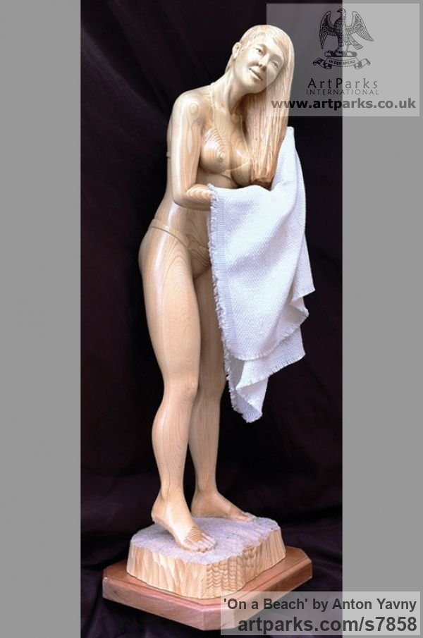 Spruce wood and fabric Females Women Girls Ladies sculpture statuettes figurines sculpture by sculptor Anton Yavny titled: 'On a beach (Carved Wood nude Naked Girl Young Woman and Towel Carving)'