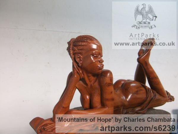Mupapa wood (found in Zambia) Females Women Girls Ladies sculpture statuettes figurines sculpture by sculptor Charles Chambata titled: 'Mountains of Hope (Carved Beautiful nude Girl statue)'