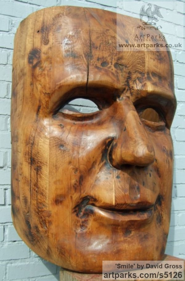 Oak Portrait Sculptures / Commission or Bespoke or Customised sculpture by sculptor David Gross titled: 'Smile (Large/Giant/Outsize 1m tall Face Mask Carvings sculpture/statue)'
