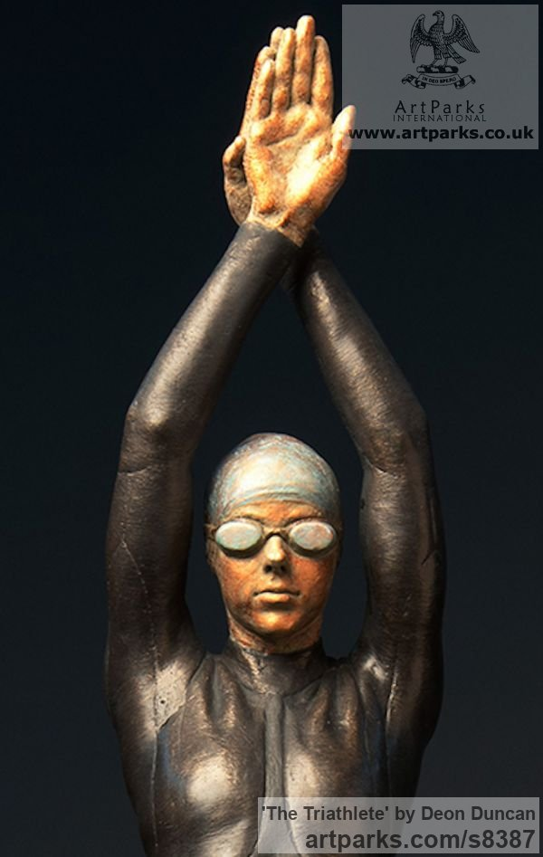 Bronze Swimmers Water Polo Divers Diving sculpture sculpture by sculptor Deon Duncan titled: 'The Triathlete (bronze female Athlete in Wetsuit statue)'