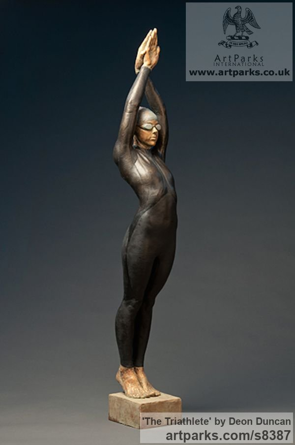Bronze Swimmers Water Polo Divers Diving sculpture sculpture by sculptor Deon Duncan titled: 'The Triathlete (bronze female Athlete in Wetsuit statue)' - Artwork View 2