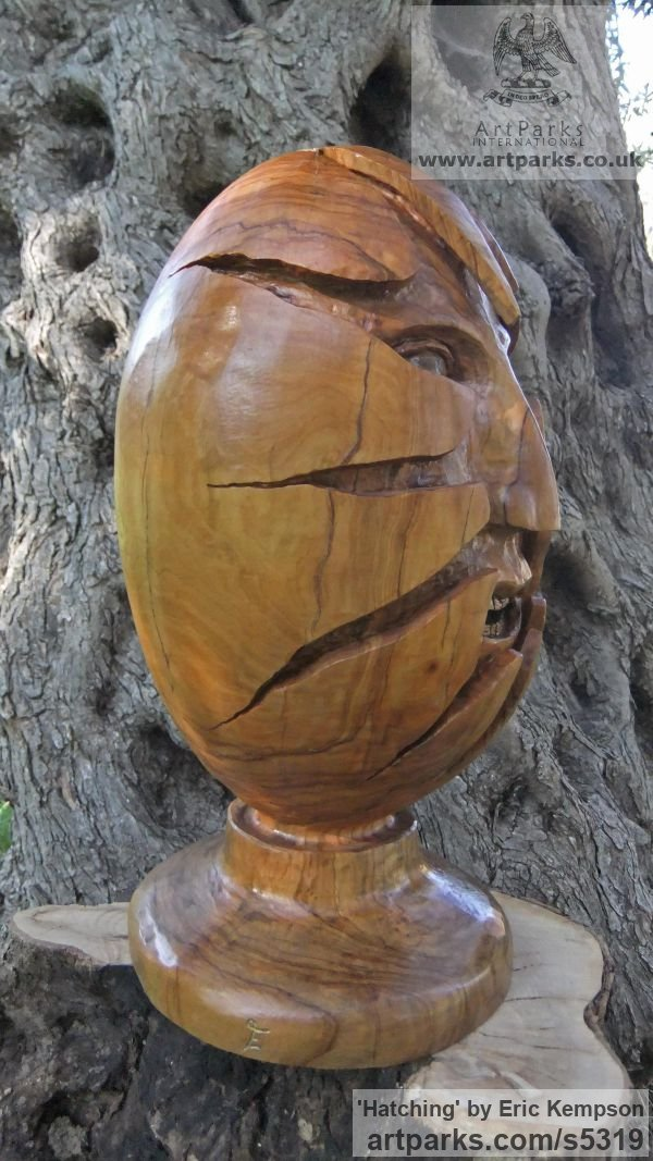 Olive wood Green Man (and Green Woman)Faces, Busts, Heads, Torsos sculpture by sculptor Eric Kempson titled: 'Hatching (Face/Egg Primitive Wood Carving sculpture)' - Artwork View 4