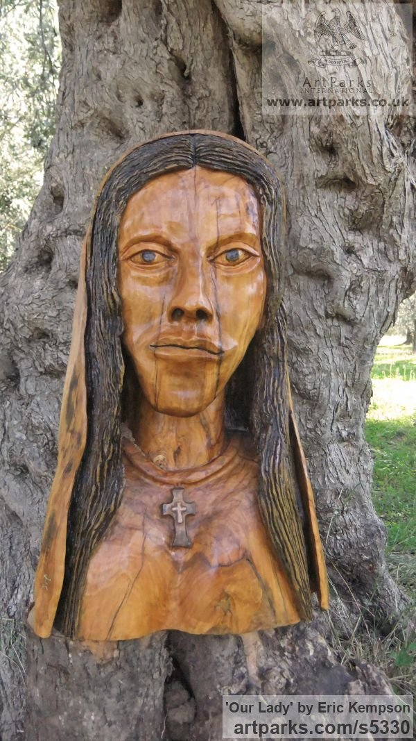 Olive wood Carved Wood sculpture by sculptor Eric Kempson titled: 'Our Lady (Naqive Madonna Carved Olive Wood statue/statuette/sculpture)'