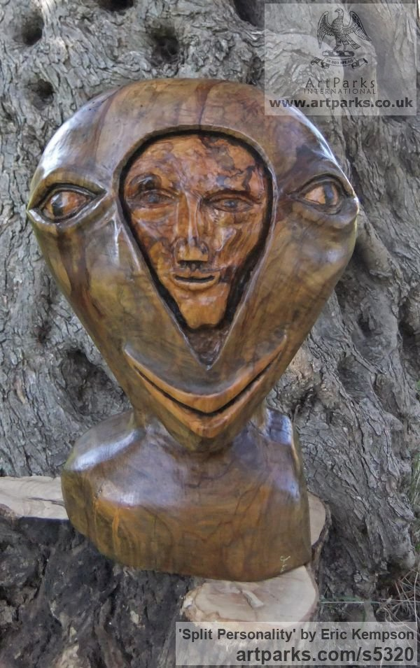 Olive wood Abstract Contemporary Modern Outdoor Outside Garden / Yard sculpture statuary sculpture by sculptor Eric Kempson titled: 'Split personality. (Semi abstract Contemporary faceWood carving)'