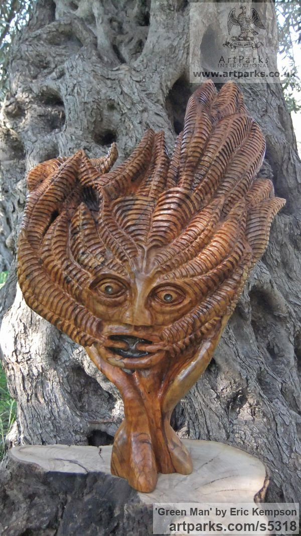 Olive wood Wall Mounted or Wall Hanging sculpture by sculptor Eric Kempson titled: 'The Green Man (Traditional Wood Suspended Wall Hung statue/Carving)'