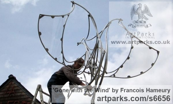 Stainless steel, polycarbonate Abstract Contemporary Modern Outdoor Outside Garden / Yard sculpture statuary sculpture by sculptor Francois Hameury titled: 'Gone with the wind'