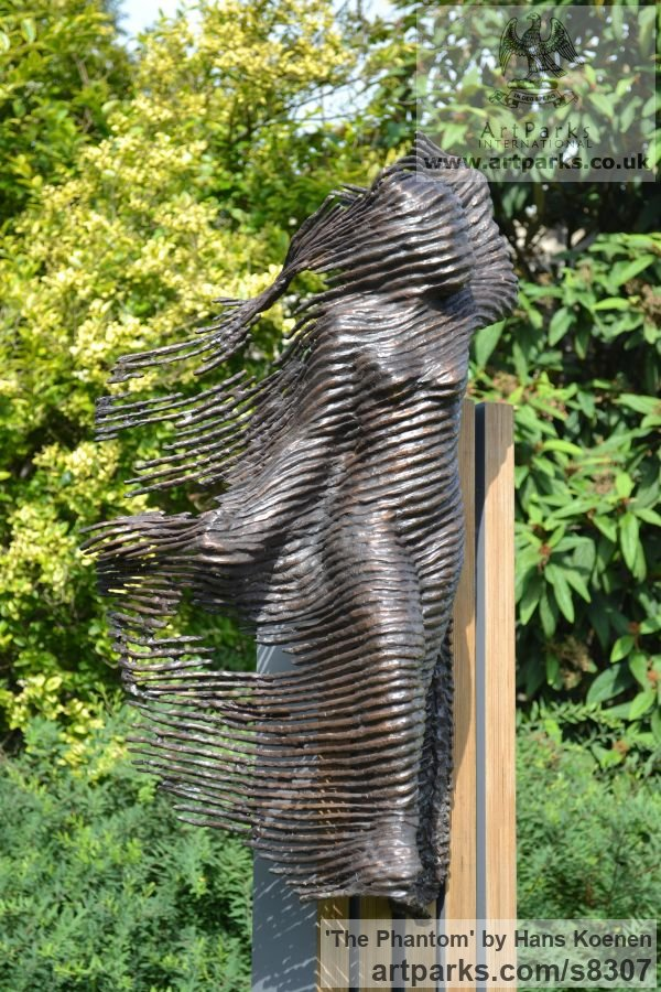 Bronze on wood Clothes Dresses Gowns Shirts etc sculpture sculpture by sculptor Hans Koenen titled: 'The Phantom (bronze female in WornRagged clothing garden statue)'