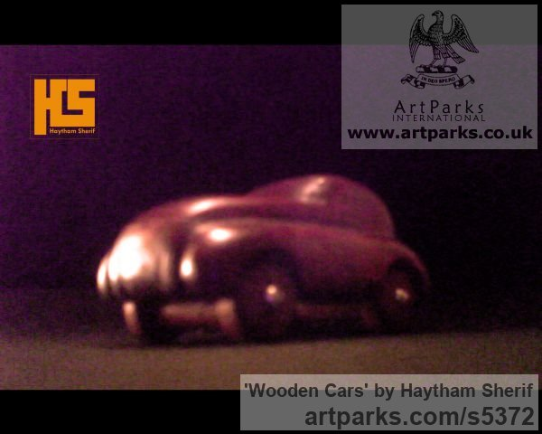 Wood Carved Wood sculpture by sculptor Haytham Sherif titled: 'wooden cars'