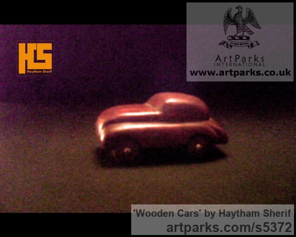 Wood Carved Wood sculpture by sculptor Haytham Sherif titled: 'wooden cars' - Artwork View 2