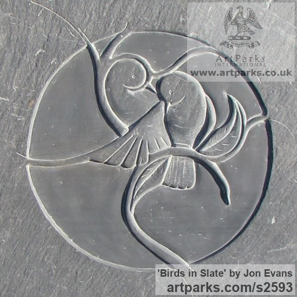 Sculpture birds in slate carved low bas relief wall