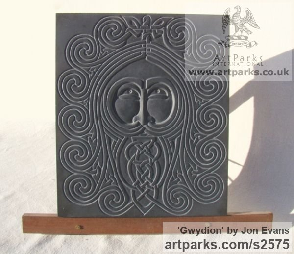 Hand carved Aberllefenni Slate (Welsh slate) Wall Mounted or Wall Hanging sculpture by sculptor Jon Evans titled: 'Gwydion (Celtic Slate Carved Face Bas Relief sculpture)'