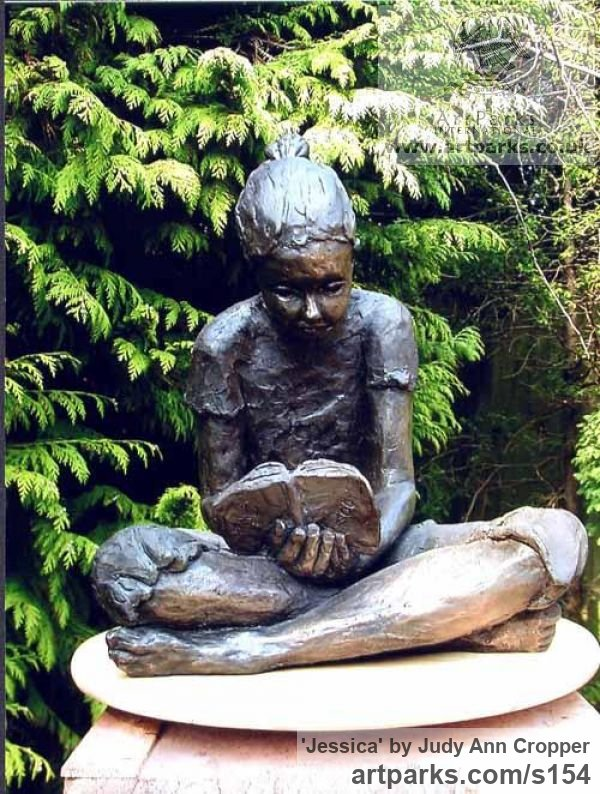 Bronze resin Portrait Sculptures / Commission or Bespoke or Customised sculpture by artist Judy Ann Cropper titled: 'Jessica (Small School Girl SiReading Book statue statuette)'