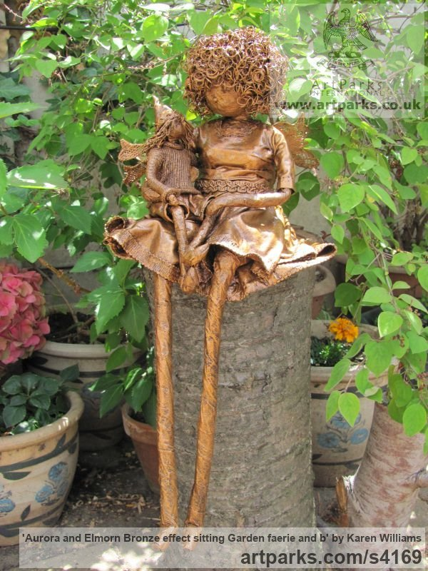 Recycled material Parent - Child sculpture by sculptor Karen Williams titled: 'Aurora and Elmorn Bronze effect sitting garden faerie and b'