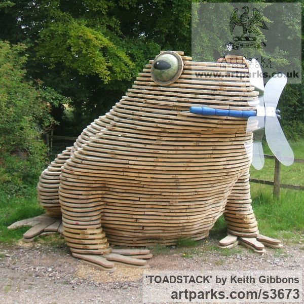 Wood/resin/copolyester Humorous Witty Amusing Lighthearted Fun Jolly Whimsical sculpture statuettes figurines sculpture by sculptor Keith Gibbons titled: 'TOADSTACK (Giant Wooden Outdoor Squatting Toad garden sculpture)'