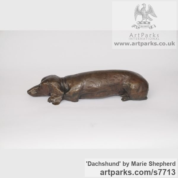 Bronze resin Garden Or Yard / Outside and Outdoor sculpture by sculptor Marie Shepherd titled: 'Dachshund (Bronze resin Sleeping Dozing Resting Lying Dog sculpture)'