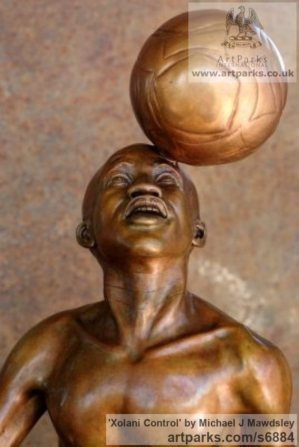 Bronze Footballers Football Players Soccer Players sculpture statuettes sculpture by sculptor Michael J Mawdsley titled: 'Xolani Control (Bronze African Footballer Balancing Football sculpture)' - Artwork View 5