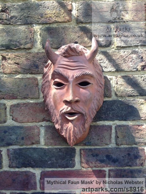 Terra Cotta Wall Mounted or Wall Hanging sculpture by sculptor Nicholas Webster titled: 'Mythical Faun Mask (Horned Devil Demon statue)'