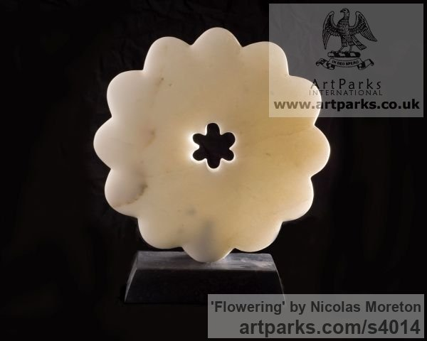 Portuguese Marble Varietal cross section of Floral, Fruit and Plantlife sculpture by sculptor Nicolas Moreton titled: 'Flowering (Small Abstrac Carved marble Circular Round Flower statues)'