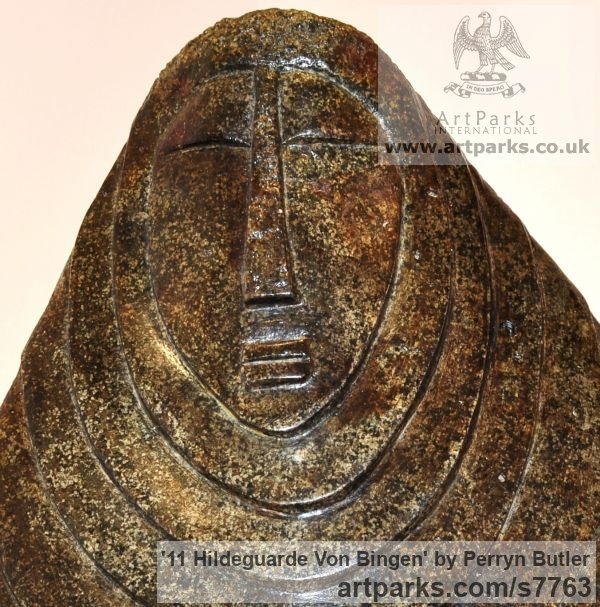 Stone carving Blue granite Abstract Contemporary or Modern Outdoor Outside Exterior Garden / Yard sculpture statuary sculpture by sculptor Perryn Butler titled: '11 Hildeguarde Von Bingen (Primitive low relief statue)' - Artwork View 3