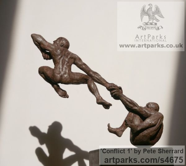 Ash resin Sculpture of Men by artist Pete Sherrard titled: 'Conflict 1 (Naked Men Swinging Emotions sculptures)'