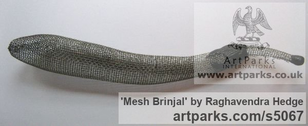 Wire mesh Varietal cross section of Floral, Fruit and Plantlife sculpture by sculptor Raghavendra Hedge titled: 'Mesh Brinjal (Outsize Indoor Pepper or Chile Fruit sculptures)'