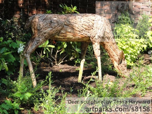 Deer sculpture by sculptor Tessa Hayward titled: 'Feeding Doe (Scrap Wood and Bark life size Deer statue)'