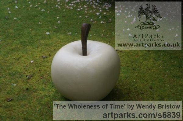 Maltese Limestone with wooden stalk Garden Or Yard / Outside and Outdoor sculpture by sculptor Wendy Bristow titled: 'The Wholeness of Time (Big Carved stone Apple Outdoor sculpture)' - Artwork View 3