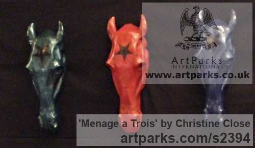 Resin Wall Mounted or Wall Hanging sculpture by sculptor Christine Close titled: 'Manege a Trois (3 Horse Head Painted Hanging statue/plaques)'