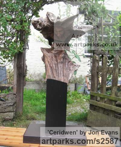 Oak & slate Garden Or Yard / Outside and Outdoor sculpture by sculptor Jon Evans titled: 'Ceridwen (Semi Natural CarvedTree trunk Wood Witch sculpture carving)'