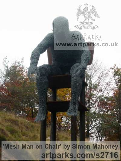 Steel, galvanized wire, plastic and wood Male Men Youths Masculine sculpturettes figurines sculpture by sculptor Simon Mahoney titled: 'Mesh Man on Chair (Chicken Wire Mesh Seated Man Stylised sculptures)' - Artwork View 2