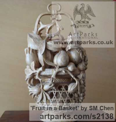 Camphor Wood Varietal cross section of Floral, Fruit and Plantlife sculpture by sculptor SM Chen titled: 'Fruit in a Basket (Chinese Carved Wall Fruit Basket statue)'