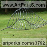 Foliage Leaves Carvings Sculpture Statues by sculptor artist Adrian Payne titled: 'Fallen Leaf (Big Outsize Iron Skeleton garden statue)' in Iron