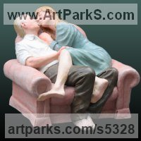 Indoor figurative sculpture by sculptor artist Andrew Benyei titled: 'Preferred Attitude (Fun Mature KissingCouple statue)' in Hydrocal