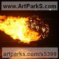 Surrealist Sculpture by sculptor artist Aragorn Dick-Read titled: 'Fireball sculpture on Water (Big Steel Outdoor sculptures)' in Metal