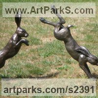 Hares and Rabbits Sculpture by sculptor artist Christine Close titled: 'Harespring 1 (Mad March Hares Running and Jumping garden statues)' in Coloured resin