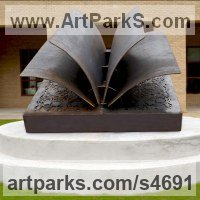 Books by sculptor artist Deedee Morrison titled: 'A Matter of Fiction (fabricated Steel BookOutdoor sculpure statue)' in Corten steel, lexan and interior light