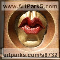 High Relief or Haute Relief Carving Sculpture Wall Panel casting in Bronze / Copper by sculptor artist Edward Fleming titled: 'Dame Fun Beso (Framed Pursed Kissing Lips sculpture)' in Bronze