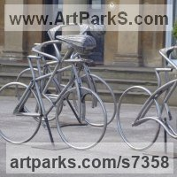 Stylized People Sculpture by sculptor artist Graham Anderton titled: 'Cyclist (Life Sze Yorkshire Tour de France Bicycle sculpture statue)' in Steel