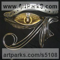 Wall Mounted or Wall Hanging sculpture by sculptor artist Graham Anderton titled: 'The Eye Horus (Steel Metal Wall Hung Modern/abstract statue/sculpture)' in Polished steel