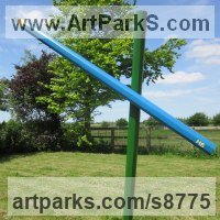 Conceptual Art Sculpture Statues often Large or Monumental Abstract Art by sculptor artist Henrietta Bud titled: 'Colouring in Grass and Sky (Large version - Fun Lawn crayon statue)' in Wood and steel