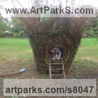 Willow, Bark and mosssculpture / statue / statuette by sculptor artist Hester Pilz titled: 'Nest' in Willow