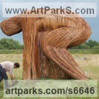 Willow, Bark and mosssculpture / statue / statuette by sculptor artist Hester Pilz titled: 'Willow Man (Giant/Large/Big/outsize Crouching Male garden/Yard statue)' in Willow on steel frame