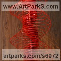 Spiral Twisted sculpture / statue / carving by sculptor artist Ivan Black titled: 'Red Serpentine (Suspended Coloured Red Helix sculptures)' in Aluminium
