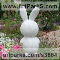 Animal Form: Abstract Sculpture by sculptor artist James Sutton titled: 'Toy III (Carved marble Childs Toy Rabbit statuettes/sculpture)' in Portuguese marble