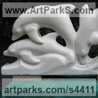 Animals and Birds at Play Sculpture Statues by sculptor artist Jeff Birchill titled: 'Wave Dancing - (Dolphin Family playing statuettes)' in Alabama marble