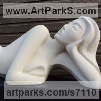 Indoor figurative sculpture by sculptor artist Jo Ansell titled: 'Irisha (Young female Lying Prone Carved stone Modern sculpture)' in Handmade marble / mineral stone