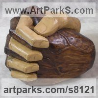 Friendship Friends chummyness Amicability Camaraderie Cordility Kindred Spirit by sculptor artist Luigi Bartolini titled: 'My hands (Big Clasping Brown and White Hands carving)' in Lime wood