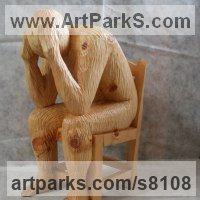 Carved Wood Sculpture by sculptor artist Luigi Bartolini titled: 'Regret (Carved 3/4 life size Man Chair sculpture)' in Arolla pine wood