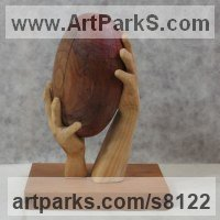 Carved Wood Sculpture by sculptor artist Luigi Bartolini titled: 'Two Hands, One Ball, (Carved Wood Rugby Ball carving statue sculpture)' in Lime, eucaliptus woods